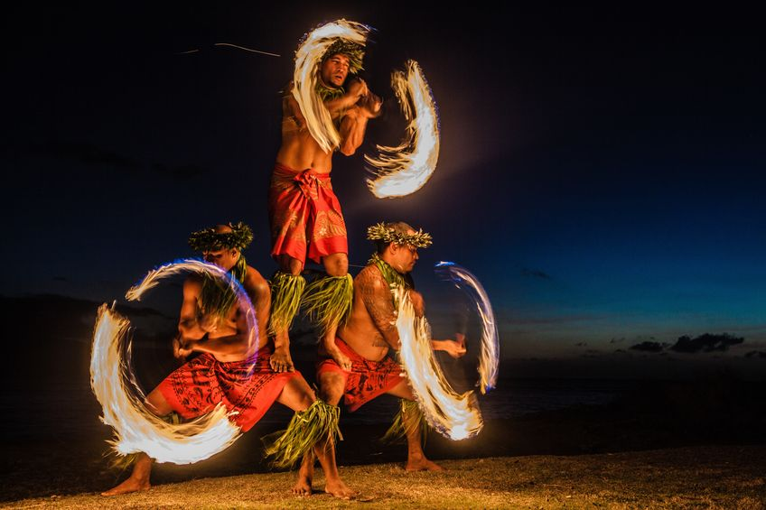 A Picture of Three Men Juggling Fire in Hawaii